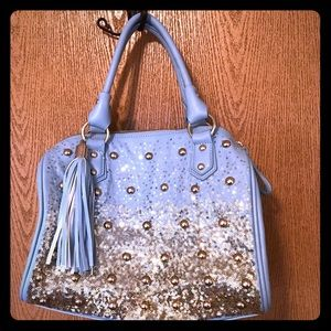 Flashy bowling bag style purse.